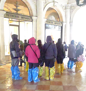 Tourist enjoy San Marco even with the high water.