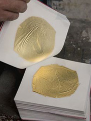 Making the gold leaf really thin.